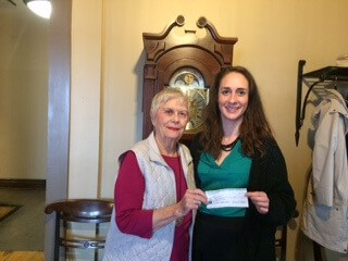 Photo: Ms. Janice Sutton presenting a cheque for $10,000 to Kathleen White of Resolve Counselling Services Canada
